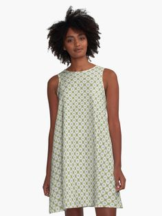 Daisy Pattern Yellow A-Line Dresses by Terrella.  Rings of white daisy like flowers around small octagons joined by darker geometric shapes and lines on a yellow background. • Also buy this artwork on apparel, phone cases, home decor, and more.