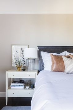 Brown leather throw pillows and black wooden headboard: http://www.stylemepretty.com/living/2016/07/27/how-to-rock-not-one-but-two-pink-sofas-in-your-home/   Photography: Alyssa Rosenheck Photography - http://alyssarosenheck.com/