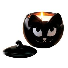 "Our wide-eyed black cat with the sly smile holds candles or candies. Decal on ceramic. Food safe. 5"" h, 4 1/2 ""dia."