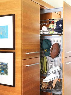 Tight Space Solutions              Tight spaces don't come with a lot of swing room, so install narrow pullout cabinets or units with hinged doors. Tall locker-style drawers are great for separating each family member's belongings. The system features a perforated metal panel that can hold items on both sides