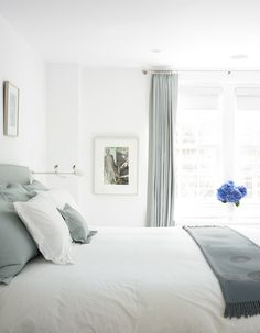 Love this bedroom in UES pre-war designed by CWB Architects..... so serene but not too bland - love how the sea blue color brings out tones in the Jasper Johns on the wall....