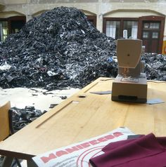 installation with the left overs from dark colored fabric, looks like charcoal, textile industry