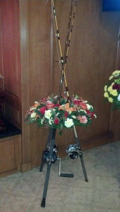 Father's favorite fishing poles used for funeral floral arrangement