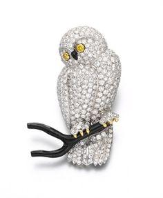 **A DIAMOND AND BLACK CORAL OWL BROOCH, BY VAN CLEEF & ARPELS