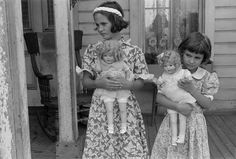 Ready for Anything. This photo shows two sisters in their sack dresses who have even helped make dresses for their dolls! It was truly an era where you did what you had to!