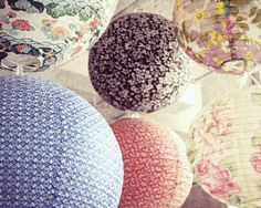 Paper Lanterns. I like the pink and brownish one in the back.