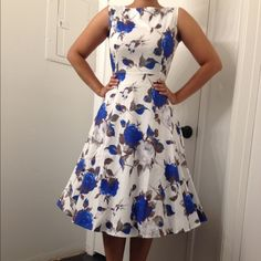 """Blue Benny Great full circle midi dress with high neck. Great fresh material that's perfect for the summer!!! Looks great with or with out crinoline! Perfect for tea parties, vintage feel and for special occasions ! Measures : 36"""" bust; 30"""" waist and 40"""" length Dresses Midi"""