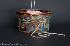 Yarn Bowl in Blue Brown with Two Curlies by KristinaChadwick. $40.00 USD, via Etsy.