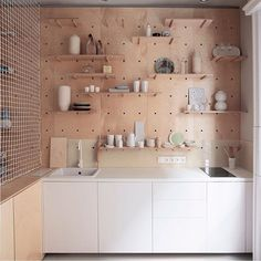 Kitchen complete with pegboard splash back by Position Collective @position_collective #budapest #accommodation #design #kitchen #interiors