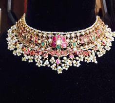 Beautiful choker with lotus flower design. Choker studded with multi color precious stones. Indian Wedding Jewelry, Indian Jewelry, Bridal Jewellery, Indian Bridal, Royal Jewelry, Gems Jewelry, Statement Jewelry, Hyderabadi Jewelry, Gold Jewellery Design