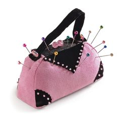 Pincushions can take on a variety of whimsical shapes. To break away from the traditional tomato, try a stuffed purse. Available from Prym-Dritz Corporation.