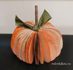 Book Crafts - Book Page Pumpkin Tutorial  ~ Make a set of these adorable book page pumpkins in various sizes and colors to use as your table decoration for your fall/Halloween parties. This is a great way to repurpose old books you have making this craft virtually free to make.