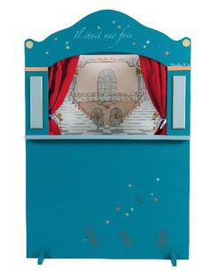 Puppet Theatre by Moulin Roty (Large wooden theatre painted midnight blue and scattered with stars. With a red velvet curtain and two removable sets of scenery: one opera-themed, the other an enchanted. Surface wash with a damp cloth. Dimensions: 120 x 80 x 17 cm Materials: Wood, MDF - 3 years old + CAD $500.0 (order at Toys and Stuff)