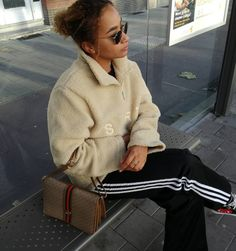 SCRT sweater, Adidas pants, CDG Play sneakers, Gucci bag.