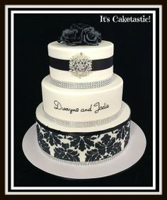 Black and White Wedding - Three tiers of white and black gorgeousness!  The damask pattern was applied to the bottom tier with royal icing.  The couple's name on the middle tier was painted on.  The bride supplied the brooch for the top tier and it was so pretty.  The roses on top were made from black fondant and the entire cake was airbrushed with pearl shimmer.  The bling on each tier really finished the cake off.