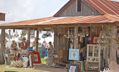 It's a Barn Sale, but don't you just love the crystal chandaliers against the rustic barn.