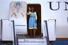 Waving: Mrs Obama is travelling to Britain with her mother and two daughters  to meet scho...