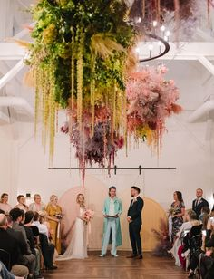 For all you rainbow lovers out there, this fun and eclectic wedding is decor goals! We're talking the coolest mismatched bridesmaids dresses, a sequin bridal gown, a rainbow flower cloud installation and more! #gws #greenweddingshoes #bohowedding #weddingdecor #rainbow #rainbowwedding