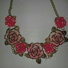 NWOT Statement necklace Very pretty necklace with pink and peachy colored roses with gold chain.  Bought it for a particular outfit but it got lost in my closet and I never wore it : (   Has BJ initials on it, but don't know for sure if its Betsey Johnson ? Jewelry Necklaces