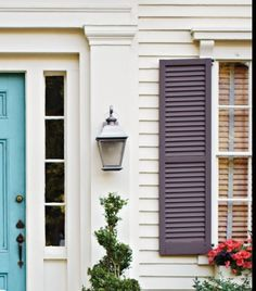 Love the combination of white hoise, blue door, gray shutters.