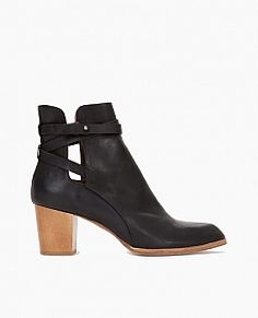 Bootie with open sides and belted detailing. The perfect year round bootie.
