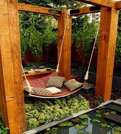 Will you just look at that. It's a swing and a hammock and a comfy couch all wrapped into one. Then they added in lots of pillows, candles, and a table for tea and snacks. And greenery. There's also zen little water feature, so you can zone out and stare at lily pads in between chapters. Someone, somewhere is serious about relaxation. And reading. // Found by @RandomMagicTour - Sasha Soren