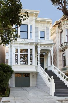 SanFrancisco row house. The visual lines are very clean and I love the contrast of the stairs and garage door