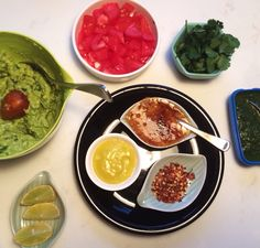 Mexican dinner condiments including homemade paprika mayo, very zesty guocamole, chermoula and herbs