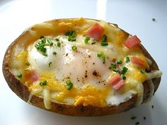 Egg Stuffed Baked Potato recipe: I love eggs. This unique adaptation to the classic stuffed baked potato makes for a wonderful meal. Make it for breakfast, lunch or dinner. Baked Potato Recipes, Egg Recipes, Great Recipes, Cooking Recipes, Favorite Recipes, Breakfast Desayunos, Breakfast Recipes, Breakfast Healthy, Health Breakfast