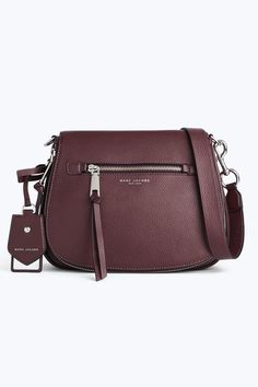 You've got to carry all your stuff around somehow--saddle up! Large enough for everything the day may ing, small enough that it won't weigh you down. Need we say more?