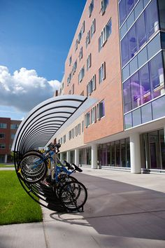 Bike Arc's vertical, artistic bicycle parking at the University of Buffalo… Bicycle Stand, Bicycle Rack, Urban Furniture, Street Furniture, Furniture Storage, Cheap Furniture, Furniture Ideas, Bike Storage Design, Bike Shelter