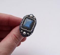 Serafina Pekkala -  Bead Embroidery Ring with  Labradorite and Pearls. $28.00, via Etsy.