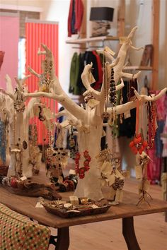 paper mache trees, jewelry display at Humanite'. Going to make something like this to hang from my wall and spray paint it gold!