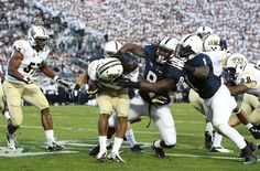 PENN STATE – FOOTBALL 2013 – Penn State Nittany Lions linebacker Gary Wooten attempts to tackle Central Florida Knights wide receiver Rannell Hall during the second quarter at Beaver Stadium. Football 2013, Football Season, Football Helmets, Pennsylvania State University, Nittany Lion, Wide Receiver, Central Florida, Social Events