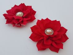 These beautiful red flowers are topped with fancy pearl rhinestone and are attached to alligator clips. Flower size: 3.4 Flower color: Red  We take pride in our unique designs, and our quality. We take time to do things right & use high quality materials. We believe that our customers deserve to be buying the very best that we have to offer.  All products are hand made in our smoke free, pet free studio! Boutique Quality Items Proudly Made in the USA. Thanks for visiting our shop