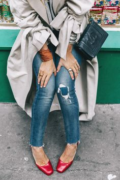 Denim details. Blogger Sara of Collage Vintage pairs her Levi's 711 skinny jeans with a grey trench and red stacked heels for a pop of color. She tops it off with a cross-body Chanel bag. See more on @WhoWhatWear.