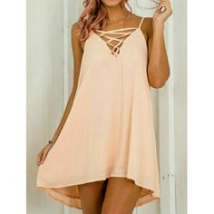 << Strappy Tie Up Front Dress Lace Up >> This dress is a must have! Comfy loose fit with tie up detail in front and a low back! Also lined! Fits true to size.  Available in small only  NWT from my boutique Twang Boutique  Dresses