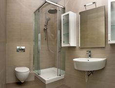 bathroom shower stalls for small bathrooms with glass wall divider combined with white wooden floating