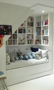Family Room: reading nook surrounded by bookshelves... this totally makes me think of you. Could be a nice place to cuddle up with one (or more) of your kids. You could have the bench hinge up to allow for more storage underneath (blankets, inflatable air mattress, other things infrequently used).
