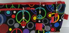Small zippered pouch / Accessory case with side tab ring - Black with multi-color Peace signs and circles / Red interior by TotesByTina on Etsy