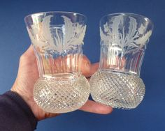 These vintage Edinburgh Thistle Shaped Whisky Glasses are hot Scottish Collectables. This is a particularly nice example pair of water glasses or whisky tumblers. The price here are for the two photographed - as are for the PAIR.  They are a rarer large size - each tumbler is 5 inches in height, and with a diameter of 3 1/4 inches.  A nice substantial example which weights unpacked 385 grams.  As you can see from my photographs (more photographs can of course be sent on request for serio...