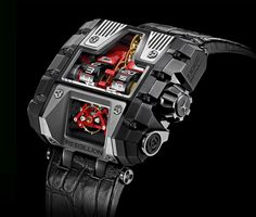 The T-1000 Gotham featuring the world's longest power reserve; vertical roller-borne hour and minute indications; and muscular case in natural and blackened titanium.