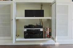 Pull out shelves and vented doors for tv components via Gardenista
