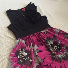 Elle Floral Dress Black and pink floral dress with elastic waist and ruffles on left shoulder. Elle Dresses