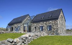 Stone House designed by Peter Legge Associates ;-Stone House designed by Peter Legge Associates ; Connemara / Ireland Stone House designed by Peter Legge Associates ; Stone Cottages, Stone Houses, Glass Houses, Farmhouse Plans, Modern Farmhouse, Modern Cottage, Cottage Extension, Beach Houses For Rent, Glass Extension