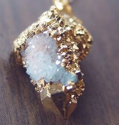 A druze coated crystal that looks like it was coated with gold leaf.