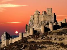 Loarre castle is a fortress in Loarre, in the Huesca province, Aragon, Spain.    It commands a magnificent situation in the foothills of the Pyrenees overlooking the vast plains of Sotonera south to Huesca and beyond.