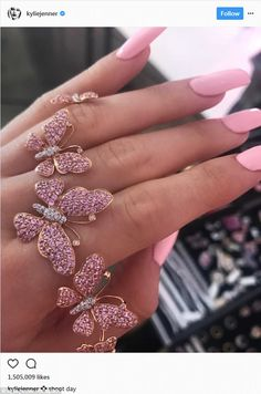 A tip? Fans think Kylie Jenner is doing a baby gender reveal photo shoot because she showed off her pink nails and pink jewelry in this Instagram photo posted Wednesday