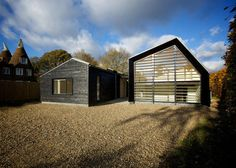 Photo by Will Layzell Photography Designed by Nash Baker Architects, the Bourne Lane house was inspired by Kent-style barns with its characteristic black timber siding and pitched roof structure. Wooden louvers help shade the interior from too much sunlight and add a layer of privacy.