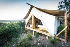 near San Diego Glampers: luxury safari cabin tent near Warner Springs in Southern California. Filled with exotic furniture built by the owners this glamping accommodation exudes sumptuousness—don't forget the incredible views of the surrounding landscape from both the bedroom and the bathroom. Imagine taking a warm bubble bath with a cup of coffee in the morning.